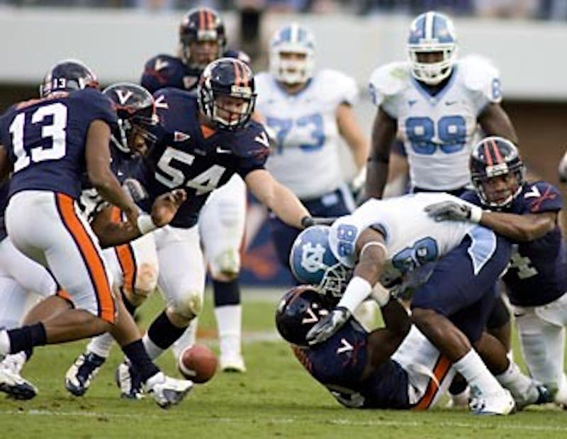 """Hakeem Nicks drops a fumble late in the third quarter of UNC?s matchup with Virginia on Saturday. The Tar Heels committed three turnovers in the game"""" bringing them to minus five in their two losses. ?The turnover battle? Cameron Sexton said ?today that?s why we lost.?"""