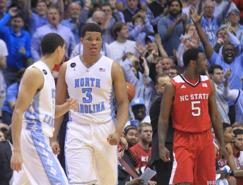 Kennedy Meeks (3) walks up the court after a foul.
