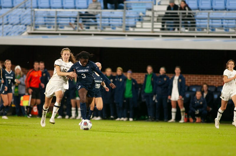 UNC redshirt senior forward Ru Mucherera (3) fights off a Notre Dame defender during the Tar Heels' 3-0 victory over Notre Dame at Dorrance Field on Sunday, Nov. 3, 2019. Mucherera scored one goal in the match.