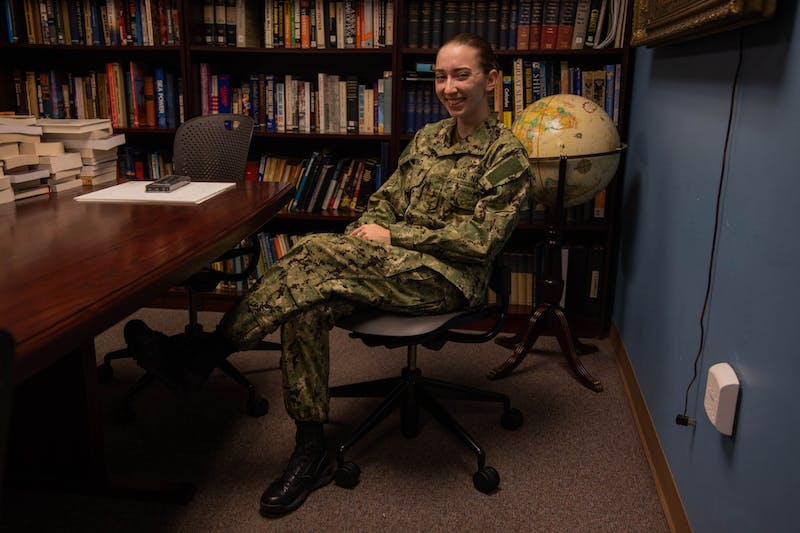 Katy Strong, a senior midshipman at the UNC Naval ROTC, poses for a portrait in the ROTC Armory on Thursday, Oct. 29, 2020. After graduation, Strong will complete her Naval Introductory Flight Evaluation, at the Naval Air Station Pensacola.