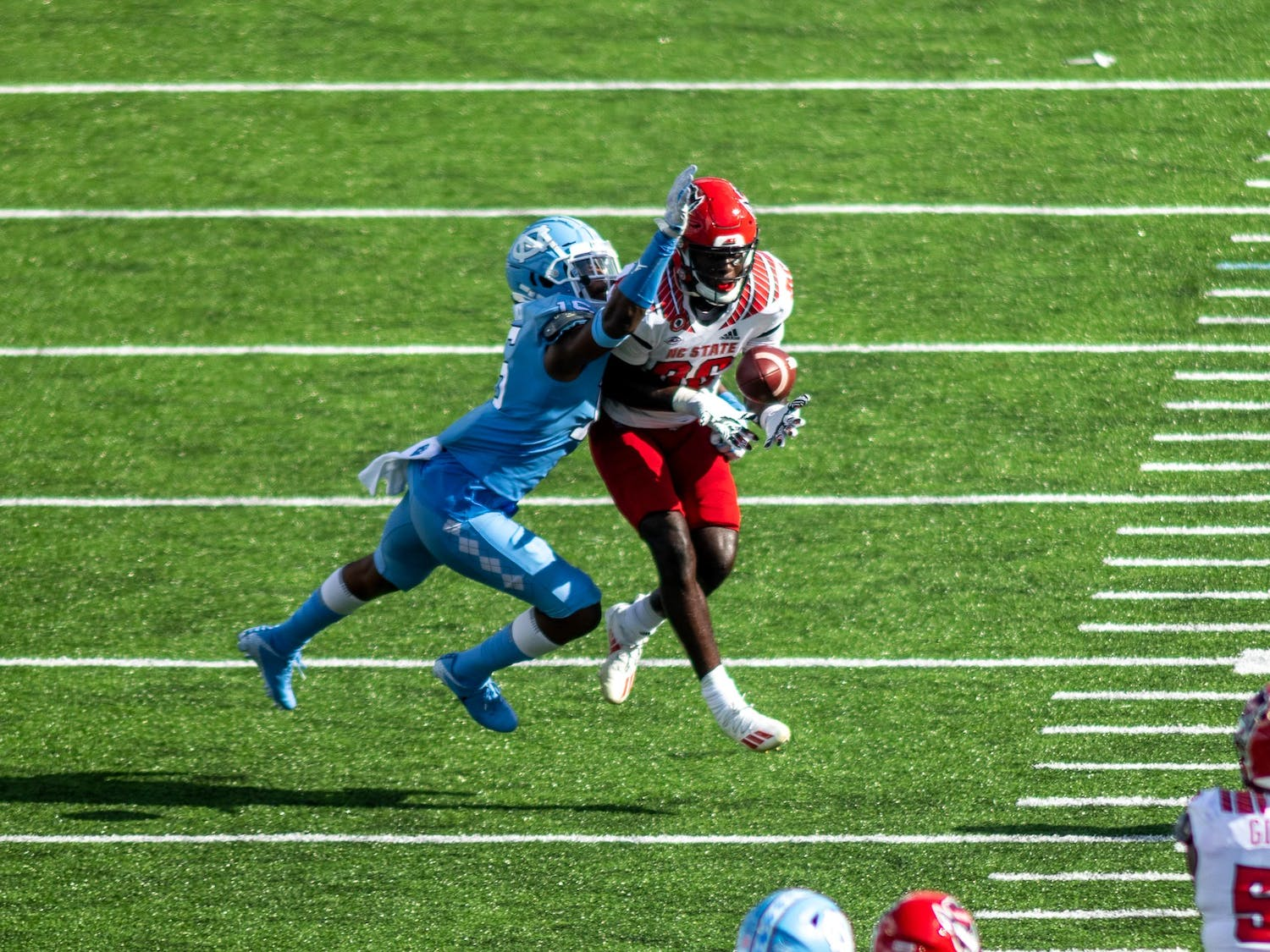 UNC sophomore defensive back Ladaeson DeAndre Hollins (15) blocks a pass in Kenan Stadium Oct. 24, 2020. The Tar Heels beat the Wolfpack 48-21.