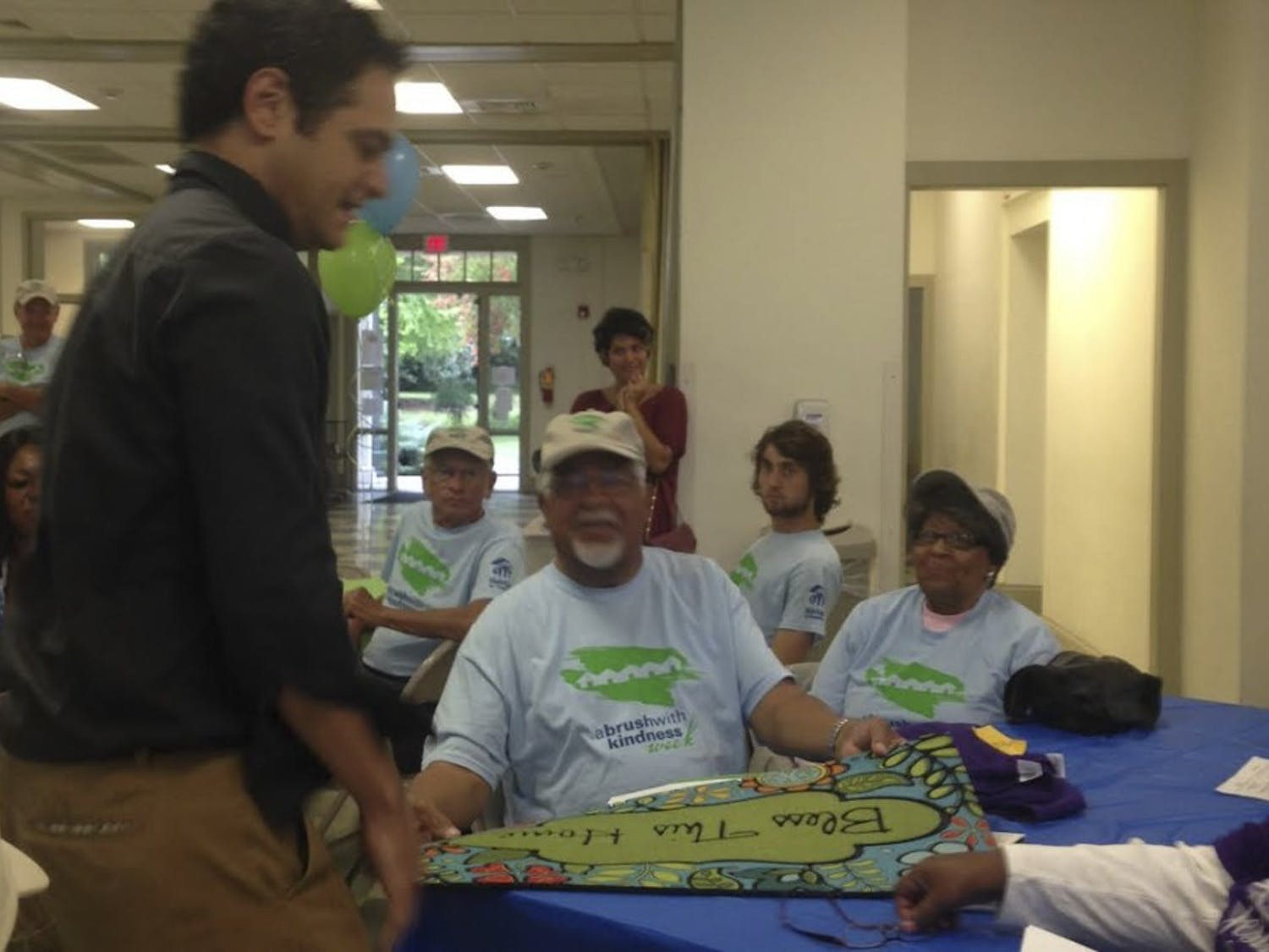 Mayor Mark Kleinschmidt (left) presents Prince (center) and Jean Taylor with a doormat and T-shirts.