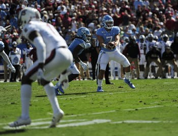 First-year quarterback Sam Howell (7) prepares to hand off the ball during during the Belk College Kick Off in Charlotte, NC on Saturday, August 31, 2019. UNC beat South Carolina 24-20.
