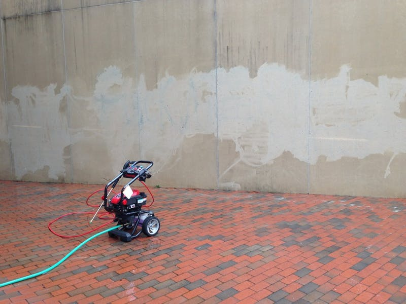 The Duke graffiti on the back of the Student Union was washed away using a sandblaster Wednesday morning.