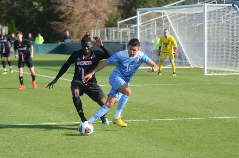 Forward Giovanni Montesdeoca (10) fights Louisville midfielder Lamine Conte (3) for the ball during Sunday's ACC Championship game at WakeMed Soccer Park. UNC lost to Louisville 1-0.