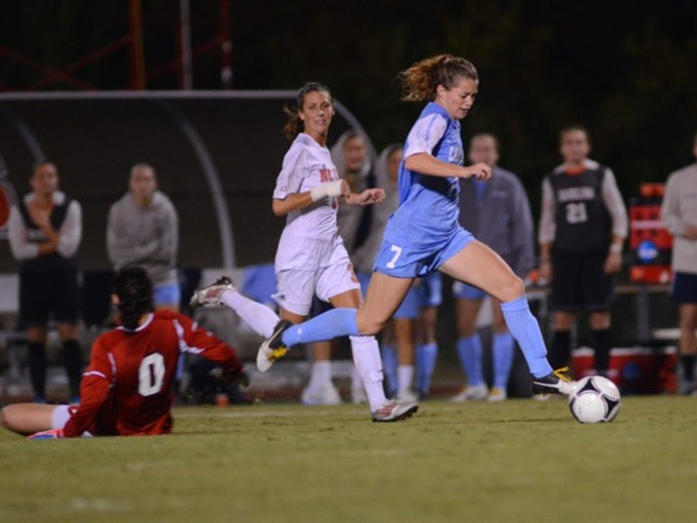 UNC Junior Kealia Ohai (7) gets past the Wolfpack Goalkeeper and scores her second goal of the night.