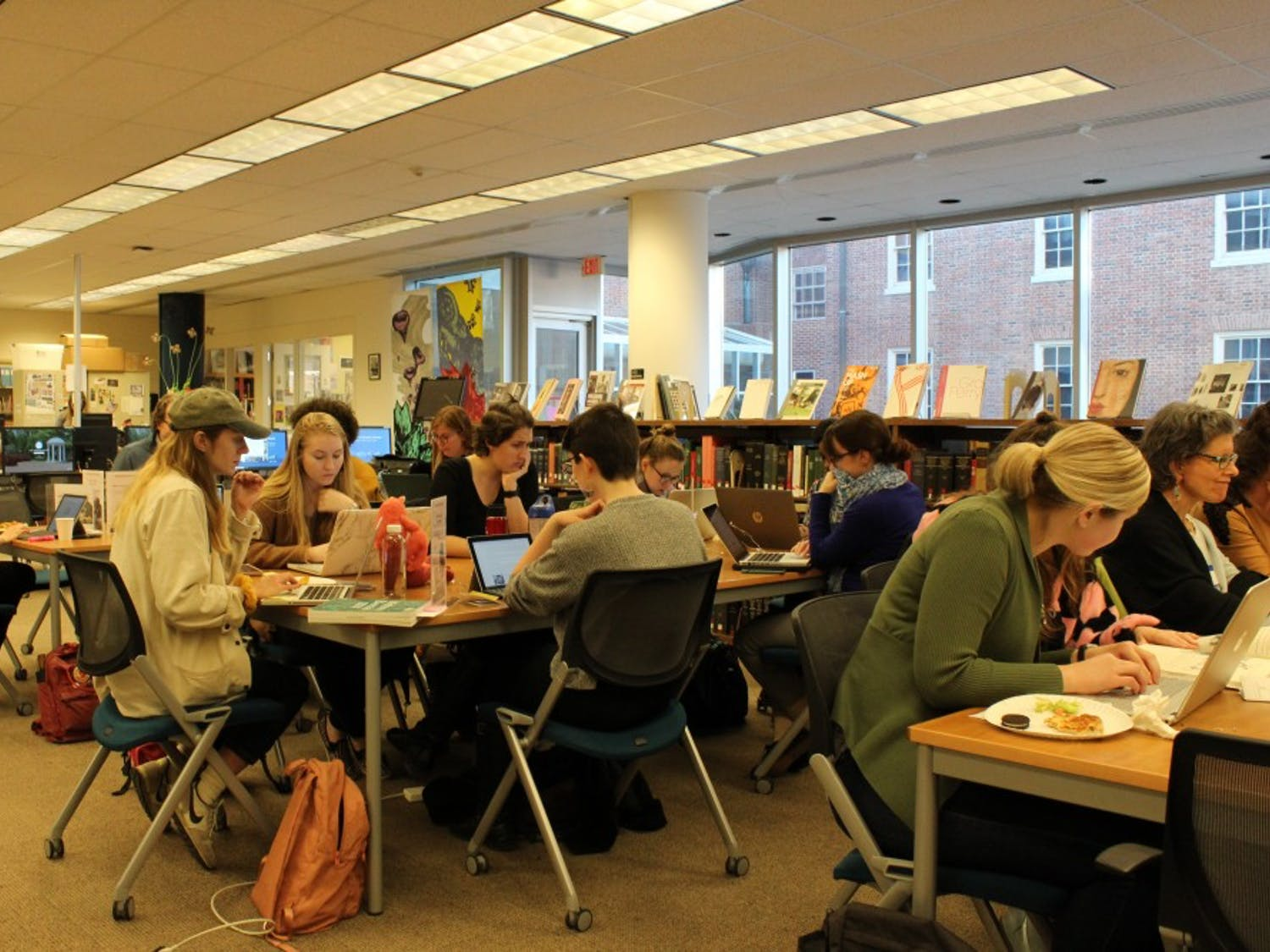 Participants of Art + Feminism Wikipedia Edit-A-Thon edit Wikipedia pages in Sloane Art Library on Tuesday, March 4, 2019. Less than 10 percent of Wikipedia editors are female, and this lack of representation leads to skewed representation. Participants come together to address this issue by editing and updating Wikipedia articles related to gender, art, and feminism.