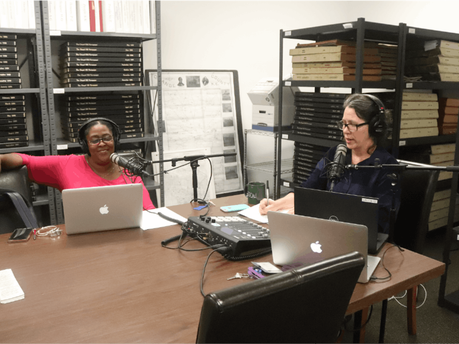 Co-hosts Danita Mason-Hogans (Left) and Molly Luby record the Chapel Hill Public Library's new local history podcast. The podcast, launched earlier this year, spends the first season discussing the history behind different monuments and markers in Chapel Hill. Photo courtesy of Omar Roque.
