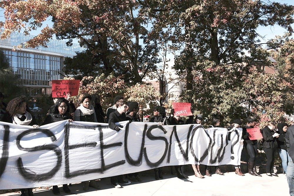 Students march to football game for better visibility