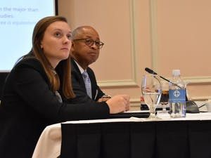 Student Body President Savannah Putnam (left) and Board of Trustees member William Keyes (right) listen to a presentation about lowering the maximum credit hours for a number of degree programs during a University Affairs committee meeting in the Carolina Inn on Wednesday, Nov. 14, 2018.