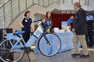 Carolyn Caggia, the Transportation Outreach Coordinator of UNC Transportation & Parking, presents information at a booth in the UNC Children's Hospital lobby.