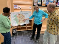 CHALT members Linda Brown (left) Julie McClintock (center) and Charles Humble (right) discuss watersheds and their environmental impacts in the Chapel Hill Public Library on Thursday, April 4th, 2019.