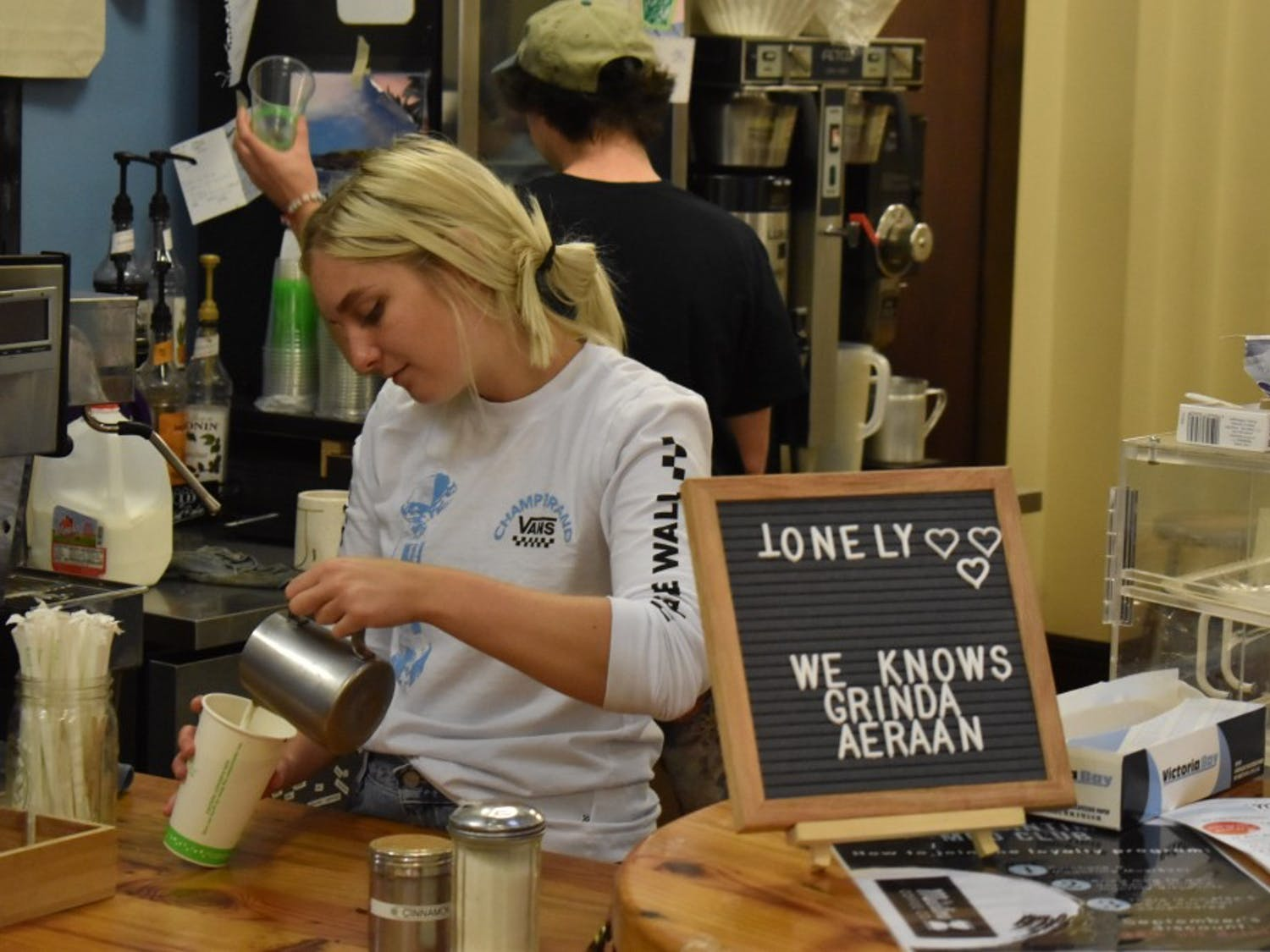 Henry Cutting, a senior at UNC, and Victoria Tyson, a junior, are baristas at the UNC student started, managed, and run coffee shop out of the campus Y, the Meantime.