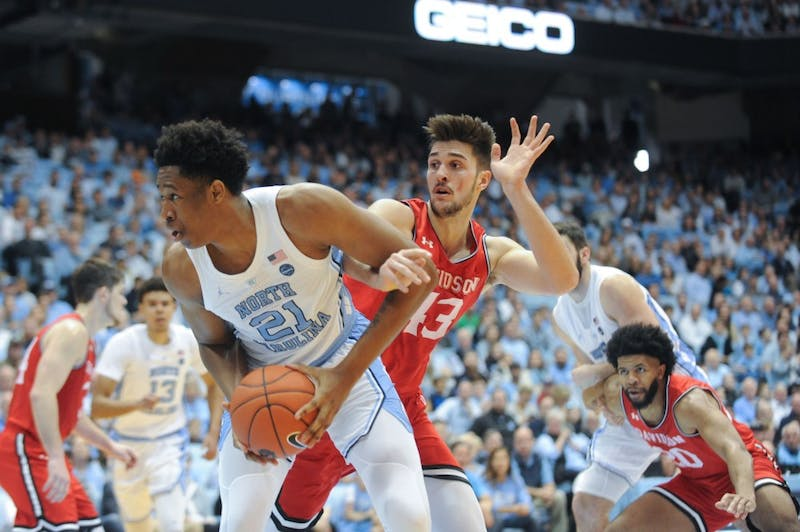 UNC forward Sterling Manley (21) is fouled by Davidson forward Dusan Kovacevic (43) in the Dean Dome on Saturday afternoon. UNC won 82 - 60.