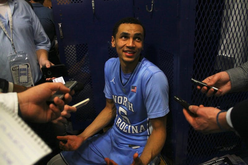 Marcus Paige (5) laughs while talking with the media in the locker room after the team's 76-72 victory over Duke.