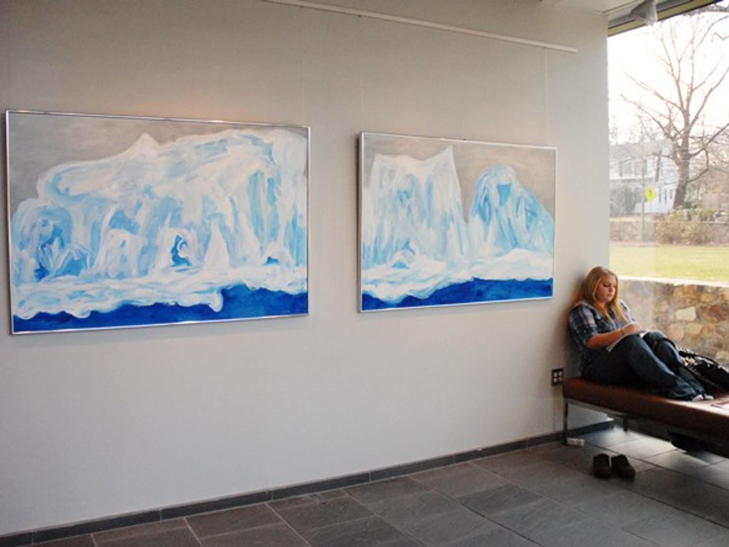 """Freshmen Parker Jackson studies Monday in the FedEx Global Education Center near a painting part of """"Ice Counterpoint"""""""