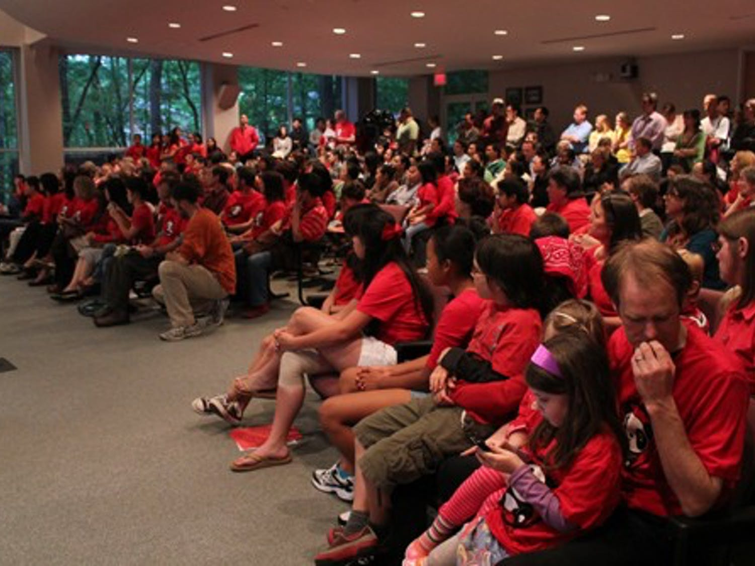 Audience members of the Chapel Hill town meeting on Thursday night wore red t-shirts to show their support for the Chinese dual language program.