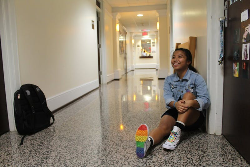 Janae Gamara sits in her hallway on Wednesday night at the Pride Place Residential Community.