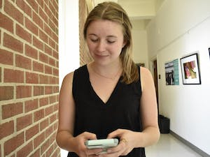 Junior public relations major, Molly Brice downloads the new FAFSA phone app on Monday, Oct. 1, 2018.