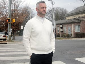 Bill Leone stands at the corner of Henderson and Rosemary streets, near where he was 20 years ago when he tackled Wendell Williamson.