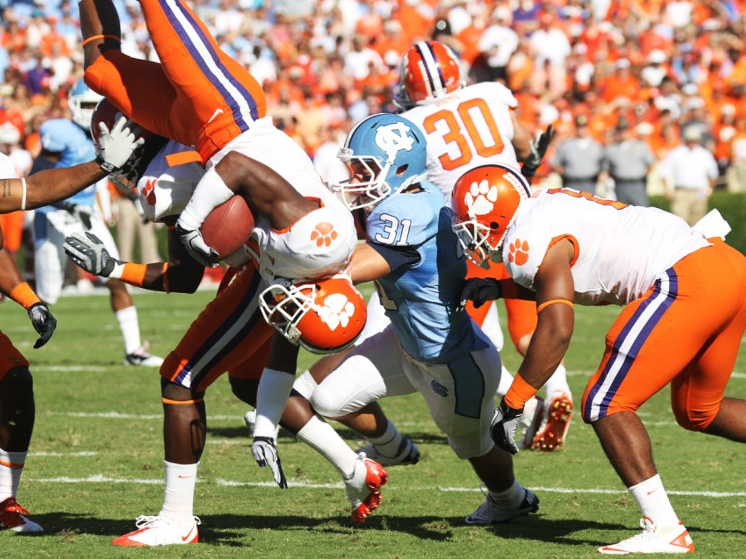 The Tar Heels flipped Clemson on its head, beating the Tigers for the first time since 2001. UNC held Clemson's potent rushing attack to just 3.4 yards per rush.