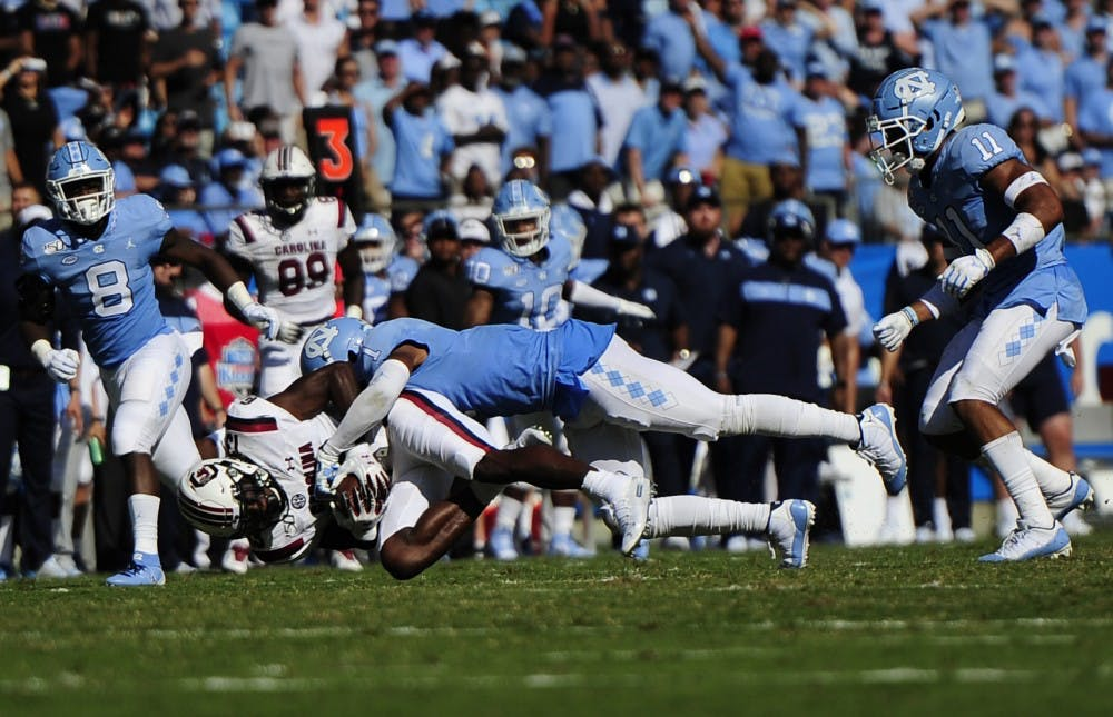 UNC football wins against South Carolina with late interceptions, improved defense