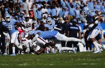 Senior defensive back Myles Dorn (1) tackles USC's quarterback during the Belk College Kick Off in Charlotte, NC on Saturday, August 31, 2019.