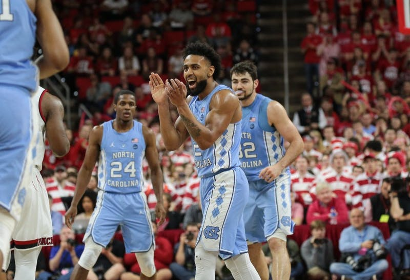 Guard Joel Berry II (2) celebrates during North Carolina's 96-89 win over N.C. State on Saturday, Feb. 10, 2018 at PNC Arena.