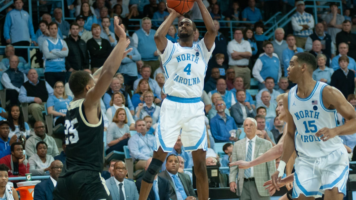 UNC's senior guard Brandon Robinson (4) attempts to shoot while junior forward Garrison Brooks (15) looks on during a game against Wofford on Sunday, Dec. 15th, 2019 at Carmichael Arena. This is the first regular-season game the Tar Heels have played in Carmichael since 1986. UNC fell to Wofford 64-68, marking UNC's third consecutive loss.