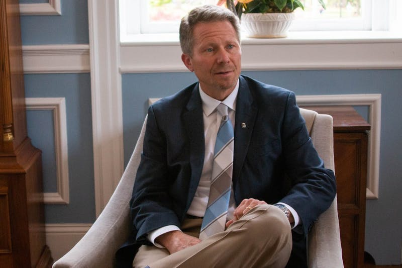 """Interim Chancellor Kevin Guskiewicz fields a reporter's question during an interview in South Building on Wednesday, April 17, 2019. """"I've heard students express concern over the distrust that they have with police... and I remain committed to ensuring their safety,"""" Guskiewicz said."""