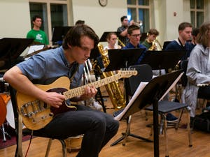 Senior Bobby Frith plays the guitar during the Charanga Carolina rehearsal in Kenan Music Building on Tuesday, Feb. 11, 2020. The Latin American music style has Cuban roots but draws inspiration from many different music styles to shape it's own unique sound.