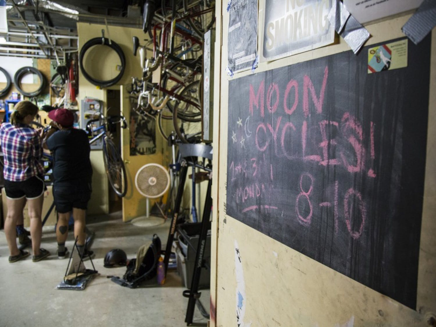 Victoria Petermann (left) and Ryann Giorgi work on fiixing a bike at a bi-weekly Moon Cycles meeting on Sept. 7, 2015. The group was founded by Giorgi, Petermann, Jolie Day, and Hannah and began meeting in November, 2014.