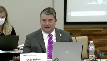 Chairperson James Holmes Jr. speaks at the Board of Governors' Committee on Budget and Finance meeting on Wednesday to address fundings allocated for COVID-19, adjustments for tuition for in-state and out-of-state students next year and school fees.