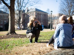 Sophomore advertising and public relations major Rainey Scarborough takes a photo of her friend, junior media and journalism major Claudia Benfield, in the Quad on Wednesday, Jan. 27, 2021.