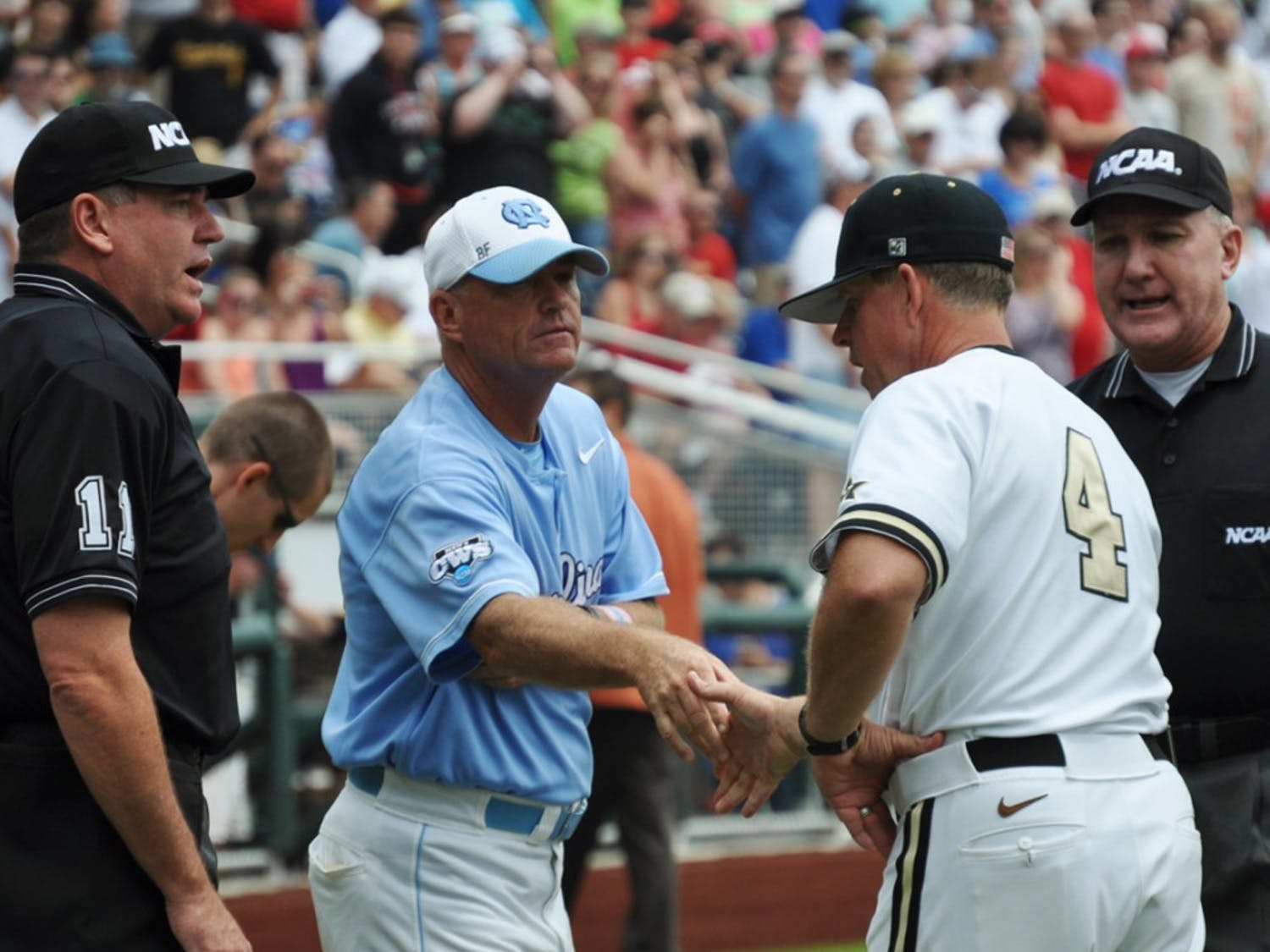 Mike Fox shakes the hand of Vanderbilt's head coach Tim Corbin. Vanderbilt would go on to knock UNC out of the College World Series.