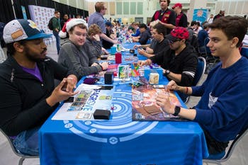 Blaine Hill (bottom right corner), competitive Pokémon trading card game player and UNC first year, playing a match at a regional championship.