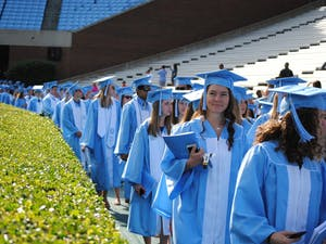 Seniors line up to walk onto Kenan Stadium for their Spring Commencement Sunday, March 8, 2016.