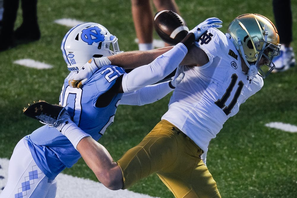 <p>UNC's first year center back Tony Grimes (20) blocks a pass to Notre Dame's graduate wide receiver Ben Skowronek (11) during a game in Kenan Memorial Stadium on Friday, Nov. 27, 2020. Notre Dame beat UNC 31-17.</p>