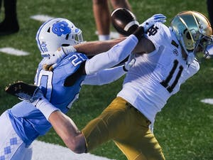 UNC's first year center back Tony Grimes (20) blocks a pass to Notre Dame's graduate wide receiver Ben Skowronek (11) during a game in Kenan Memorial Stadium on Friday, Nov. 27, 2020. Notre Dame beat UNC 31-17.