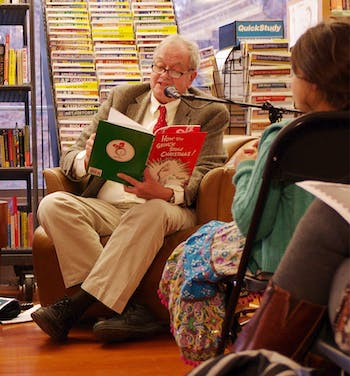 """UNC Student Stores employee George Morgan (left) and Professor Tom Stumpf (right) read """"How the Grinch Stole Christmas"""" in Latin and English at Bull's Head Bookshop's annual reading."""