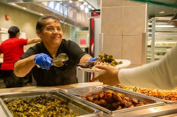 CDS employee Francisca Ventura serves food from Latinx communities on Thursday, Sept. 26, 2019 at Lenoir Dining Hall in Chapel Hill.