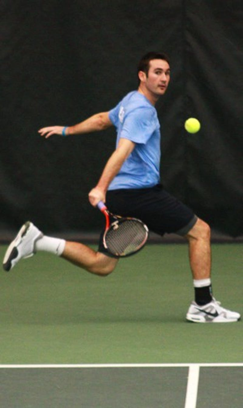 Senior Stefan Hardy slices a backhand shot against a Navy player Tuesday. UNC went on to a 7-0 win against the Midshipmen.
