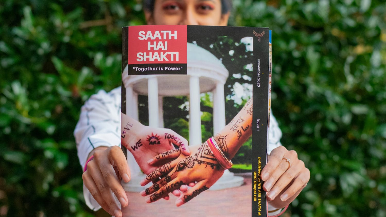 Hrishika Muthukrishnan, a senior neuroscience major and editor-in-chief of the new student-run South Asian publication, SAATH HAI SHAKTI, shows off the front cover of the magazine's first issue on Saturday, Nov. 14, 2020.