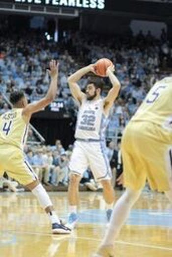 Luke Maye (32) goes to pass the ball during the Georgia Tech game at the Dean Smith Center on Saturday.