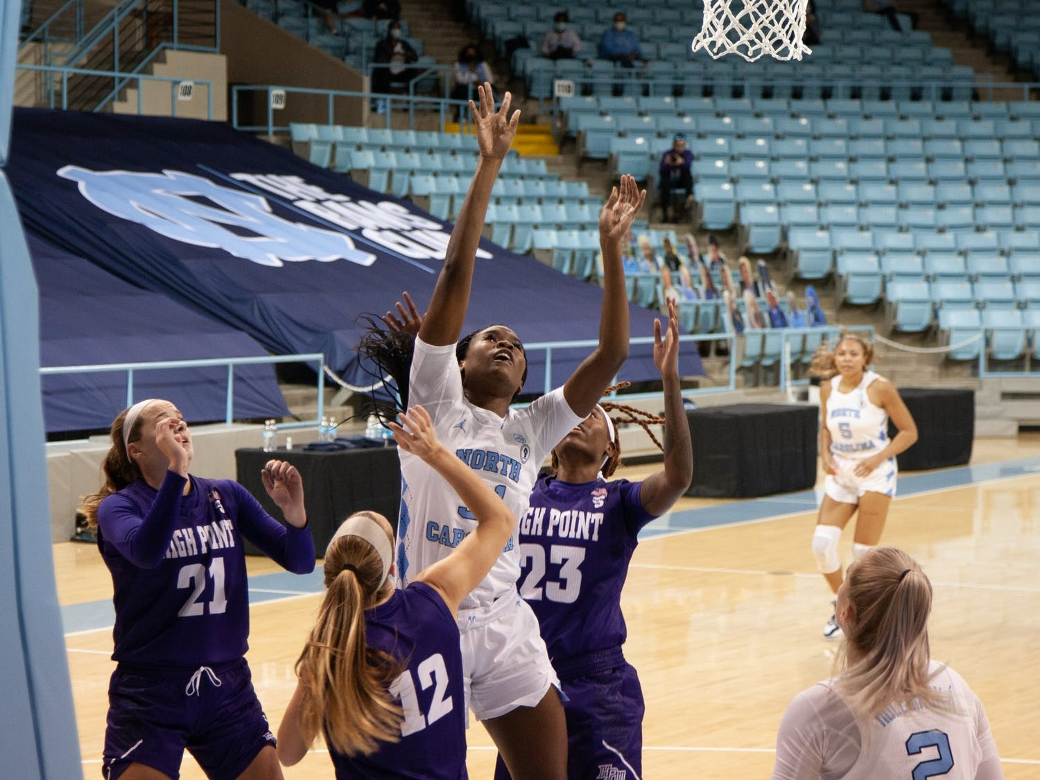 UNC first year forward Anya Poole (31) attempts a put-back shot during Carolina's 95-70 victory over High Point at Carmichael Arena on November 29th, 2020.