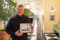 """Bill Ferris, a UNC emeritus history and folklore professor, poses with his box set, """"Voices of Mississipi,"""" in the hallway of the Carolina Inn on Friday, Feb. 1, 2018 in Chapel Hill, North Carolina. Ferris is nominated for two Grammy Awards for """"Voices of Mississippi,"""" a box set consisting of a 120-page book, featured essays by various authors, two CDs of blues and gospel recordings, one CD of interviews and storytelling, and a DVD of documentary films. """"Voices of Mississippi"""" has been nominated for Best Historical Album"""" and Best Liner Notes."""