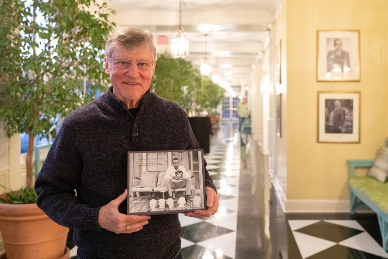"Bill Ferris, a UNC emeritus history and folklore professor, poses with his box set, ""Voices of Mississipi,"" in the hallway of the Carolina Inn on Friday, Feb. 1, 2018 in Chapel Hill, North Carolina. Ferris is nominated for two Grammy Awards for ""Voices of Mississippi,"" a box set consisting of a 120-page book, featured essays by various authors, two CDs of blues and gospel recordings, one CD of interviews and storytelling, and a DVD of documentary films. ""Voices of Mississippi"" has been nominated for Best Historical Album"" and Best Liner Notes."