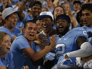 UNC senior cornerback Des Lawrence (2) celebrates the football team's last second victory over Pittsburgh with fans on Sep. 24.