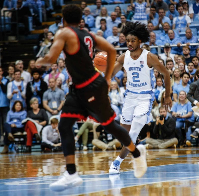 First-year guard Coby White (2) dribbles the ball down the court during Monday's game against Saint Francis at the Smith Center. UNC won 101-76.