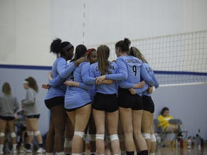 UNC's club volleyball team making a game plan during their match against Elon at their NCVF Ranking Tournament in Fetzer Gymnasium on Saturday, Feb. 23, 2019.